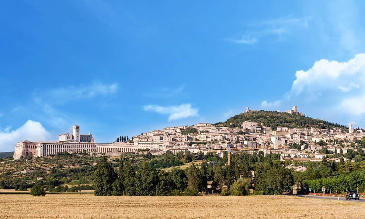 The hilltop, medieval town of Assisi from the fields below.
