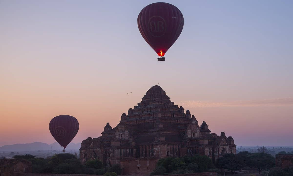Hot air balloons rise above a Pagoda on the Bagan Plains in Myanmar.