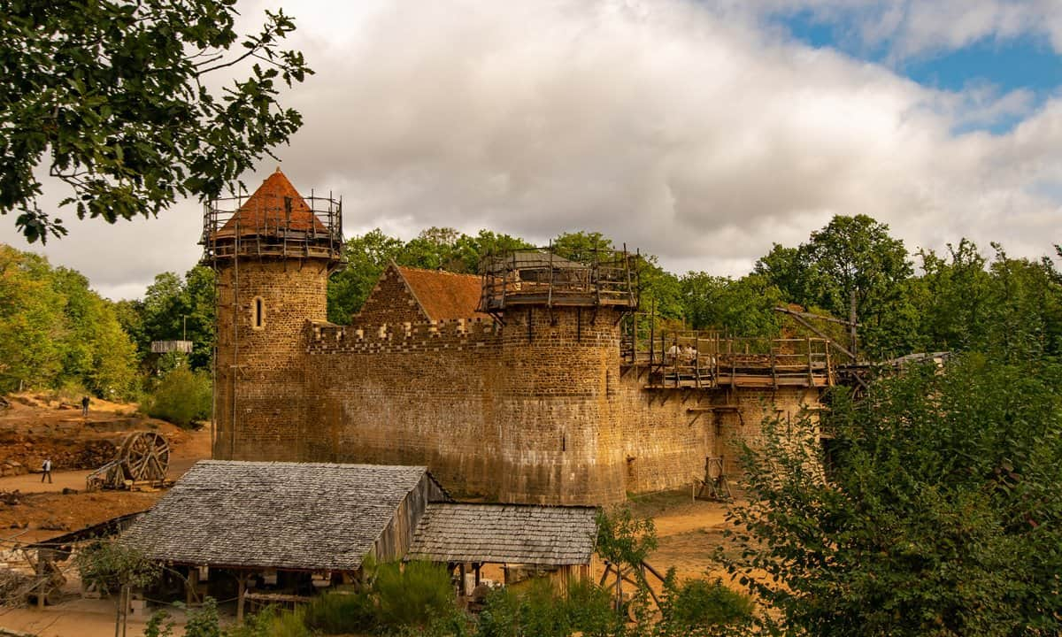 The construction site of Guédelon Castle in rural disused quarry in France.