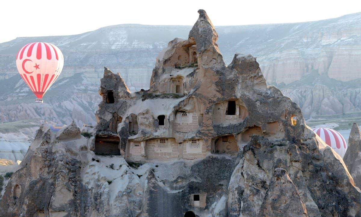 Hot air balloons floating amongst Cappadocia's fairy chimneys.