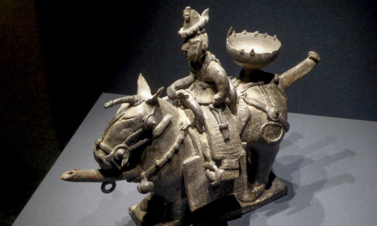 Historic ceramic sculpture of a warrior riding a horse in the National Museum of Korea.