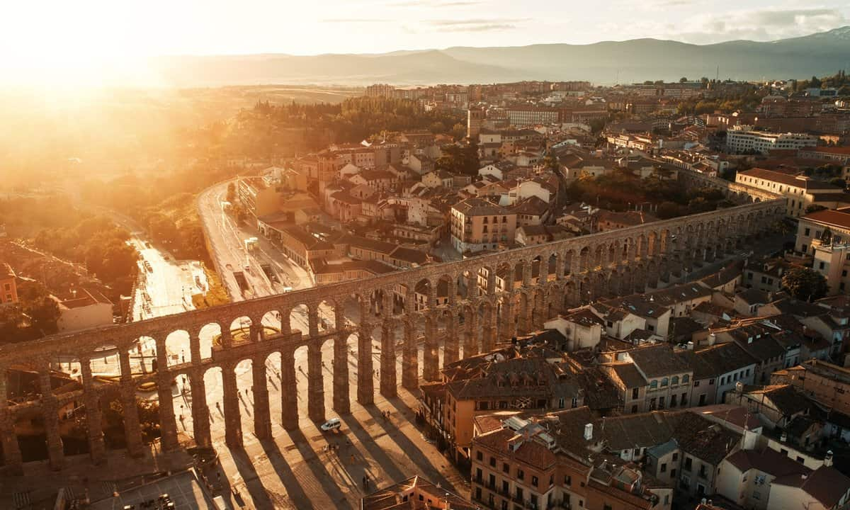 Sunrise over the Spanish town of Segovia and the Roman aqueduct from a hot air balloon.