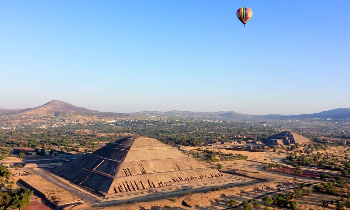 A balloon floats above the archaeological site of Teotihuacan, Mexico.