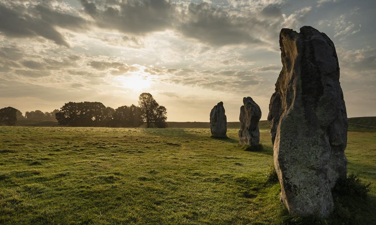 A summer sunrise at Avebury in Wiltshire, UK.