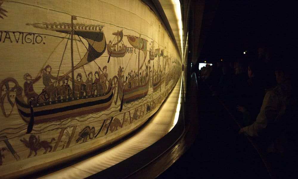 The Bayeaux Tapestry hanging in the museum in Normandy.