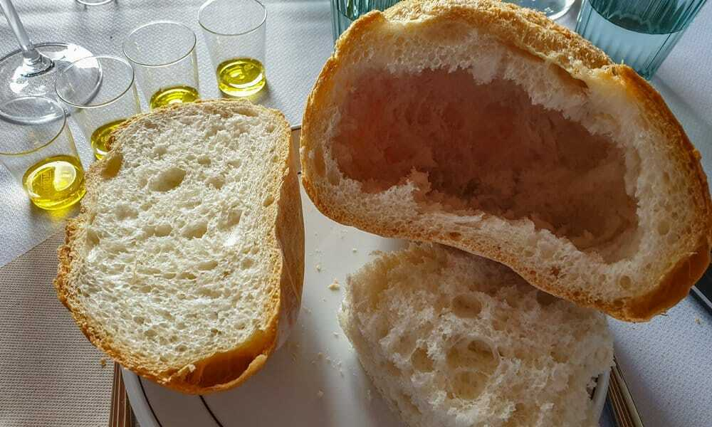 A round loaf of bread with olive oil is the base of the Cloxta.