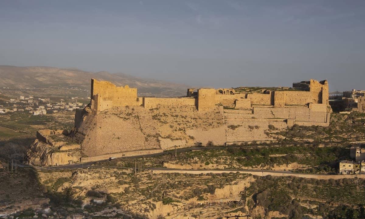 The imposing walls of Kerak Castle above the town of al-Karak, Jordan.