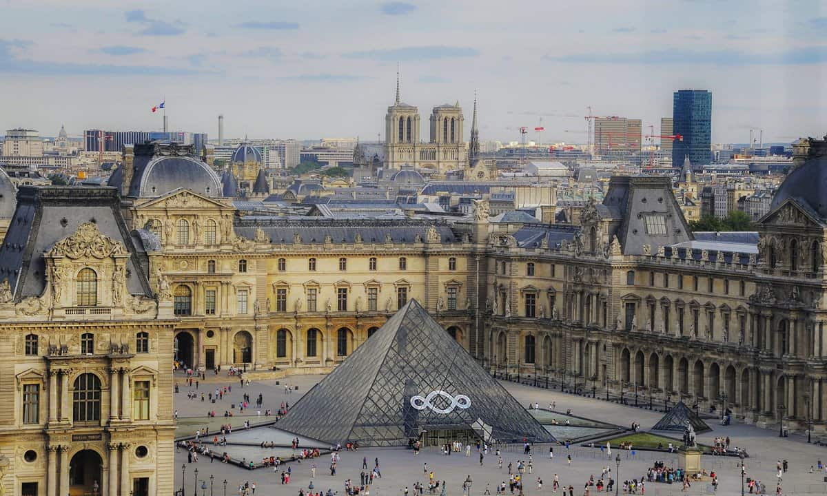 Looking on to the Napoléon courtyard with its glass pyramids that are the entry to the Louvre Museum.