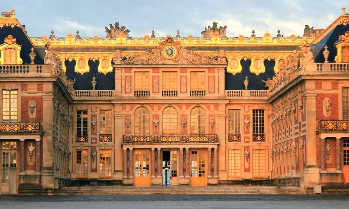 Versailles's Marble Court and façade at sunrise.