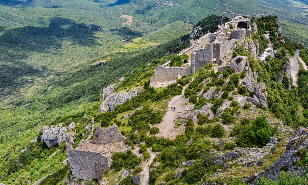 The strategic position of Peyrepertuse Castle high on a hill in the mountains of the French Pyrénées.