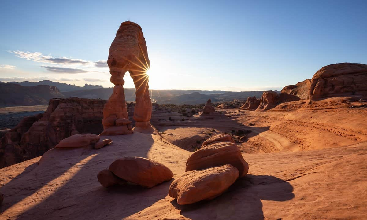 The sun setting behind Delicate Arch, Moab.