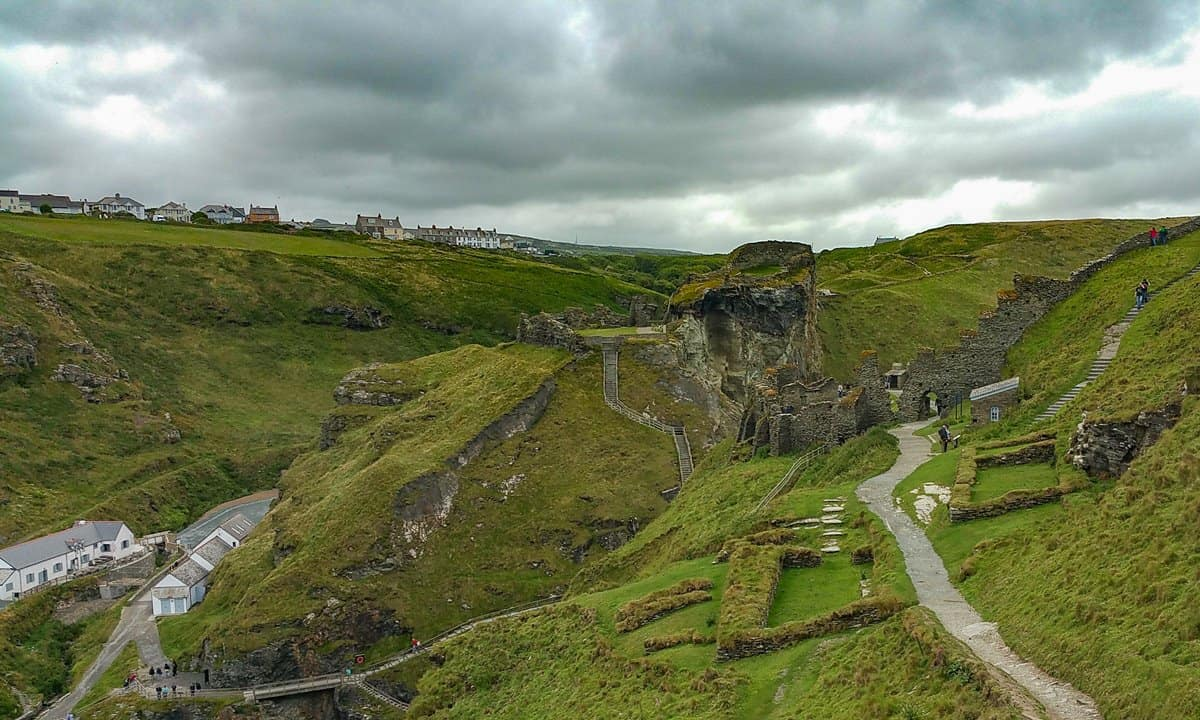 Ruins of Tintagel Castle on an overcast and dark day.