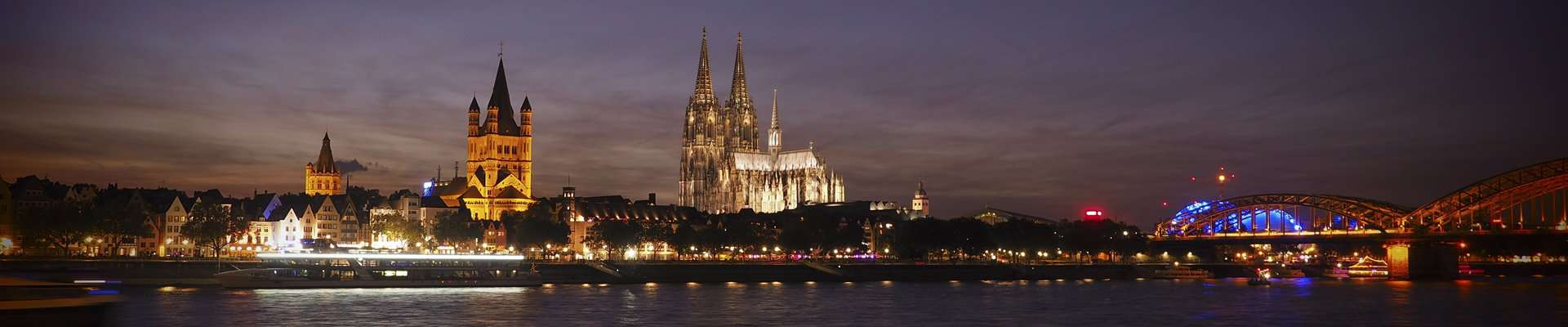 The Cologne skyline at night showing the Gothic Cathedral.