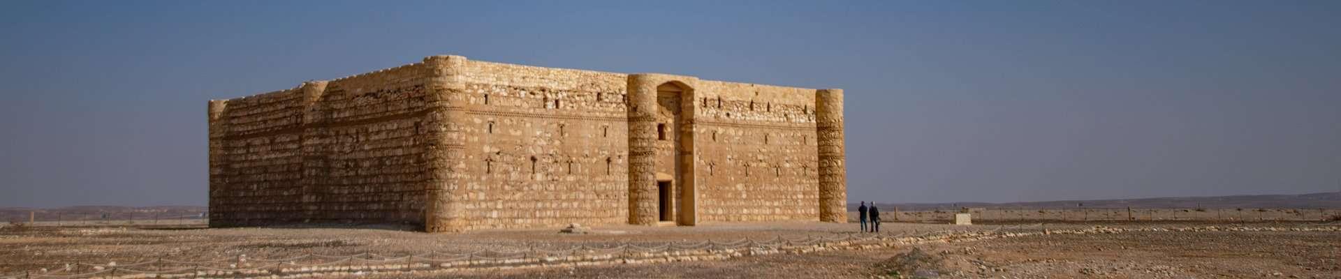The striking Umayyad Palace of Qasr Al-Kharanah in the open Jordanian desert.
