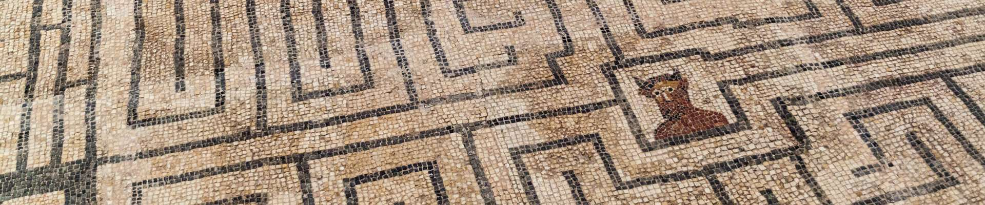 A mosaic at the Roman site of Conimbriga depicting a minotaur at the centre of a labyrinth.