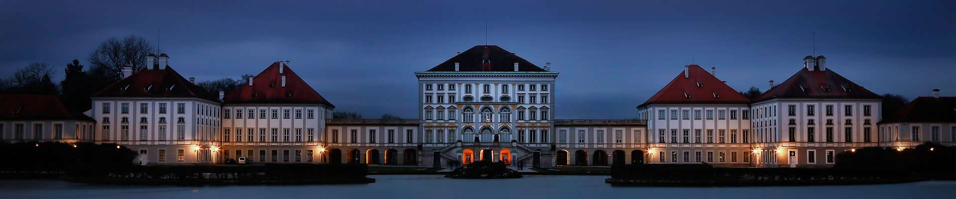 The Baroque Nymphenburg Palace in Munich at night.