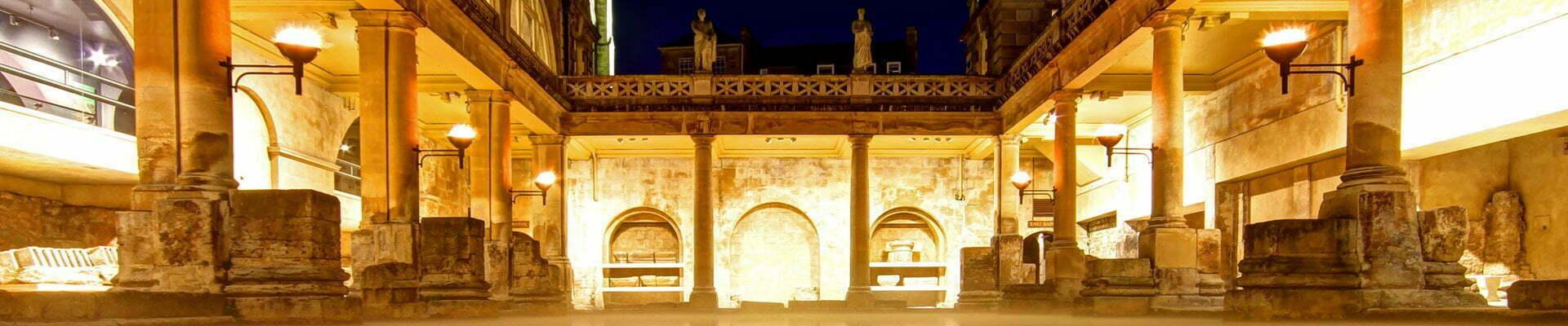 The Great Bath at night in Bath, England.