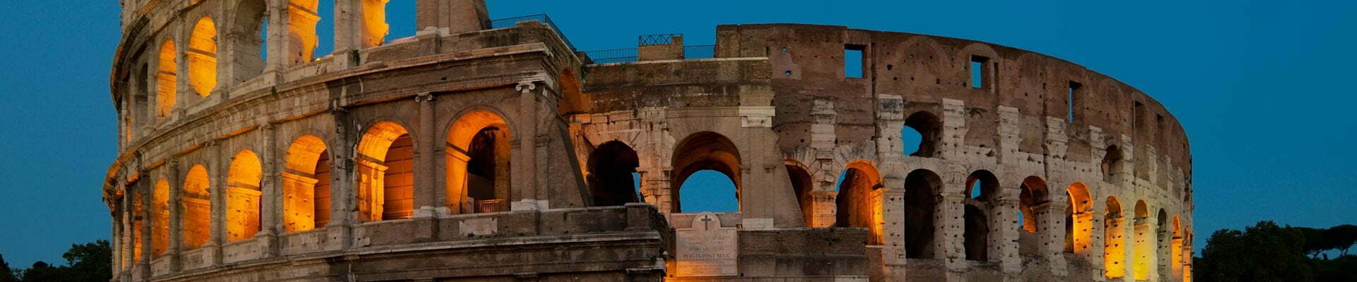 The arches of the Colosseum by night.