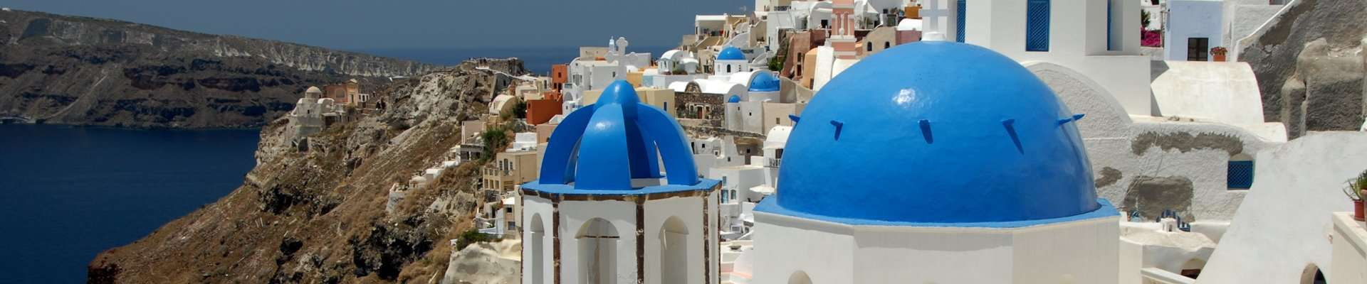 Picturesque, historic villages cling to the caldera of Santorini.