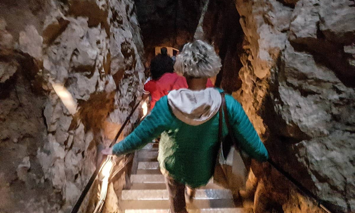 Descending the steps to the entrance of Pech Merle cave.