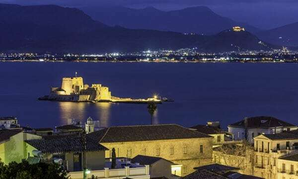 Bourtzi Castle lit up an night in Nafplio's harbour.