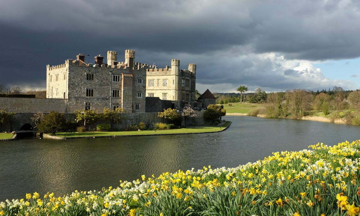 Leeds Castle in spring with daffodils in full bloom.