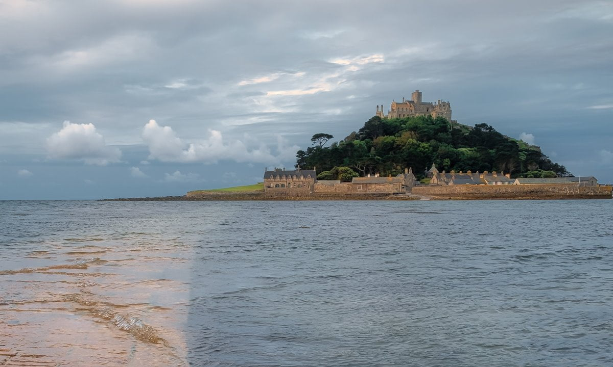 St Michael's Mount Castle is located on a tidal island on the Cornish coast.