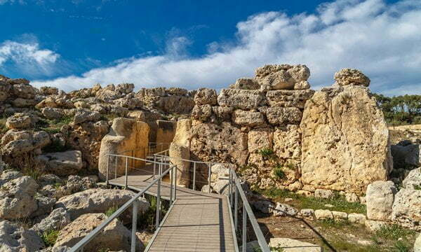 A walkway leads visitors into the Ggantija megalithic temple in Malta.