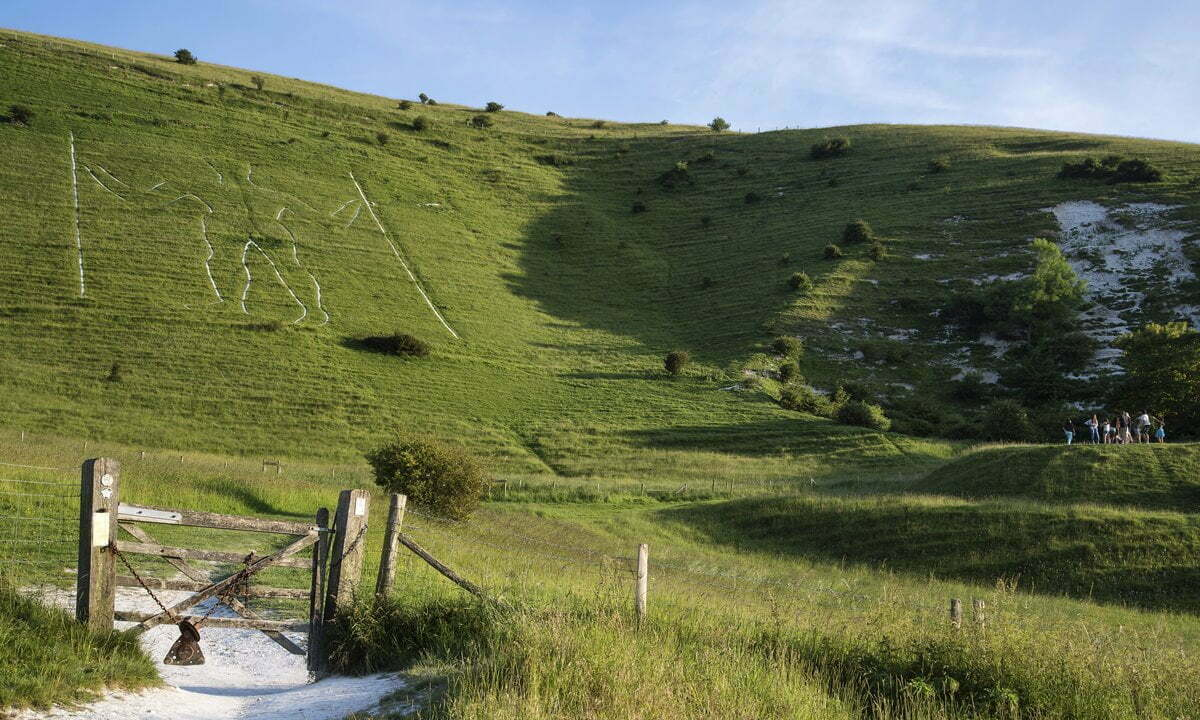 The chalk figure known as the Wilmington Giant on a hillside in East Sussex.